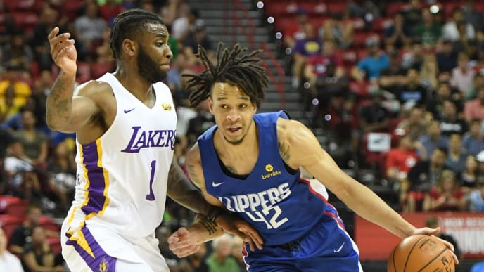 LAS VEGAS, NEVADA - JULY 06:  Amir Coffey #42 of the LA Clippers drives against Codi Miller-McIntyre #1 of the Los Angeles Lakers during the 2019 NBA Summer League at the Thomas & Mack Center on July 6, 2019 in Las Vegas, Nevada. NOTE TO USER: User expressly acknowledges and agrees that, by downloading and or using this photograph, User is consenting to the terms and conditions of the Getty Images License Agreement.  (Photo by Ethan Miller/Getty Images)