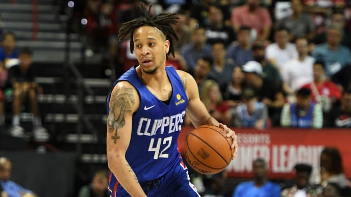 LAS VEGAS, NEVADA - JULY 06:  Amir Coffey #42 of the LA Clippers brings the ball up the court against the Los Angeles Lakers during the 2019 NBA Summer League at the Thomas & Mack Center on July 6, 2019 in Las Vegas, Nevada. NOTE TO USER: User expressly acknowledges and agrees that, by downloading and or using this photograph, User is consenting to the terms and conditions of the Getty Images License Agreement.  (Photo by Ethan Miller/Getty Images)