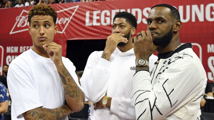 LAS VEGAS, NEVADA - JULY 06:  (L-R) Kyle Kuzma, Anthony Davis and LeBron James of the Los Angeles Lakers talk before a game between the Lakers and the LA Clippers during the 2019 NBA Summer League at the Thomas & Mack Center on July 6, 2019 in Las Vegas, Nevada. NOTE TO USER: User expressly acknowledges and agrees that, by downloading and or using this photograph, User is consenting to the terms and conditions of the Getty Images License Agreement.  (Photo by Ethan Miller/Getty Images)