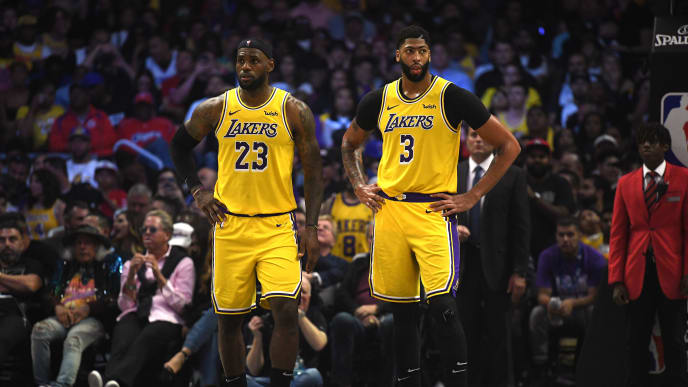 LOS ANGELES, CALIFORNIA - OCTOBER 22:   LeBron James #23 and Anthony Davis #3 of the Los Angeles Lakers reacts as they trail the LA Clippers during the fourth quarter in a 112-102 Clippers win during the LA Clippers season home opener at Staples Center on October 22, 2019 in Los Angeles, California. (Photo by Harry How/Getty Images)