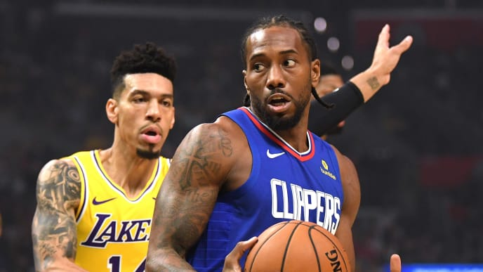 LOS ANGELES, CALIFORNIA - OCTOBER 22: Kauhi Leonard # 2 of the LA Clippers rotated for a shot before Danny Green # 14 of the Los Angeles Lakers during the 112-102 Clipper's home opener of the LA Clippers at the Staples Center in the Staples Center October 22, 2019 in Los Angeles, California. (Photo by Harry How / Getty Images)