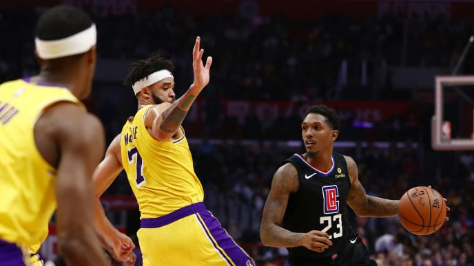 LOS ANGELES, CALIFORNIA - APRIL 05: Lou Williams #23 of the Los Angeles Clippers drives against JaVale McGee #7 of the Los Angeles Lakers during the second half at Staples Center on April 05, 2019 in Los Angeles, California. NOTE TO USER: User expressly acknowledges and agrees that, by downloading and or using this photograph, User is consenting to the terms and conditions of the Getty Images License Agreement. (Photo by Yong Teck Lim/Getty Images)