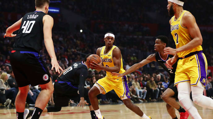 LOS ANGELES, CALIFORNIA - APRIL 05: Rajon Rondo #9 of the Los Angeles Lakers drives against Shai Gilgeous-Alexander #2 and Garrett Temple #17 of the Los Angeles Clippers during the first half at Staples Center on April 05, 2019 in Los Angeles, California. NOTE TO USER: User expressly acknowledges and agrees that, by downloading and or using this photograph, User is consenting to the terms and conditions of the Getty Images License Agreement. (Photo by Yong Teck Lim/Getty Images)