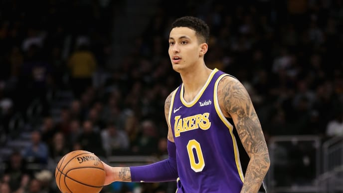 MILWAUKEE, WISCONSIN - MARCH 19:  Kyle Kuzma #0 of the Los Angeles Lakers dribbles the ball in the third quarter against the Milwaukee Bucks at the Fiserv Forum on March 19, 2019 in Milwaukee, Wisconsin. NOTE TO USER: User expressly acknowledges and agrees that, by downloading and or using this photograph, User is consenting to the terms and conditions of the Getty Images License Agreement. (Photo by Dylan Buell/Getty Images)