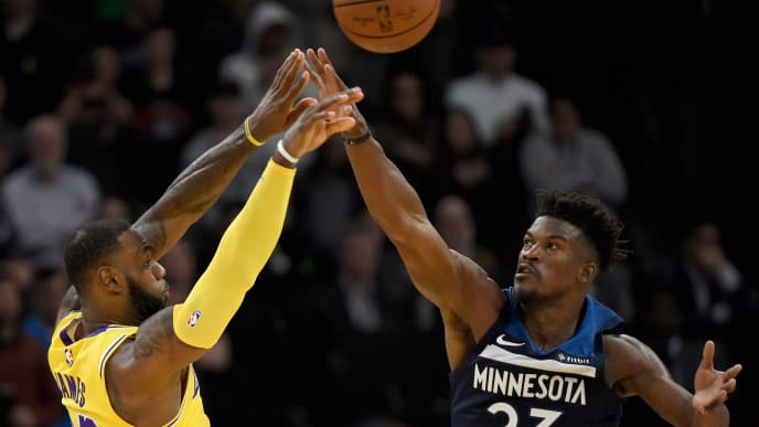 MINNEAPOLIS, MN - OCTOBER 29: LeBron James #23 of the Los Angeles Lakers passes the ball away from Jimmy Butler #23 of the Minnesota Timberwolves during the fourth quarter of the game on October 29, 2018 at the Target Center in Minneapolis, Minnesota. The Timberwolves defeated the Lakers 124-120. NOTE TO USER: User expressly acknowledges and agrees that, by downloading and or using this Photograph, user is consenting to the terms and conditions of the Getty Images License Agreement. (Photo by Hannah Foslien/Getty Images)