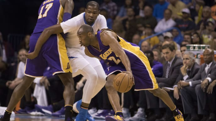 OKLAHOMA CITY, OK - APRIL 11: Kobe Bryant #24 of the Los Angeles Lakers drives around Kevin Durant #35 of the Oklahoma City Thunder during a NBA game at the Chesapeake Energy Arena on April 11, 2016 in Oklahoma City, Oklahoma. NOTE TO USER: User expressly acknowledges and agrees that, by downloading and or using this photograph, User is consenting to the terms and conditions of the Getty Images License Agreement. (Photo by J Pat Carter/Getty Images)