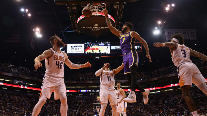 PHOENIX, ARIZONA - NOVEMBER 12: JaVale McGee #7 of the Los Angeles Lakers slam dunks the ball over Aron Baynes #46 of the Phoenix Suns during the second half of the NBA game at Talking Stick Resort Arena on November 12, 2019 in Phoenix, Arizona. The Lakers defeated the Suns 123-115. NOTE TO USER: User expressly acknowledges and agrees that, by downloading and/or using this photograph, user is consenting to the terms and conditions of the Getty Images License Agreement  (Photo by Christian Petersen/Getty Images)