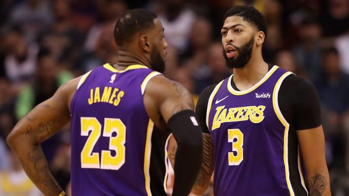 PHOENIX, ARIZONA - NOVEMBER 12: Anthony Davis #3 and LeBron James #23 of the Los Angeles Lakers during the second half of the NBA game against the Phoenix Suns at Talking Stick Resort Arena on November 12, 2019 in Phoenix, Arizona. The Lakers defeated the Suns 123-115. NOTE TO USER: User expressly acknowledges and agrees that, by downloading and/or using this photograph, user is consenting to the terms and conditions of the Getty Images License Agreement  (Photo by Christian Petersen/Getty Images)