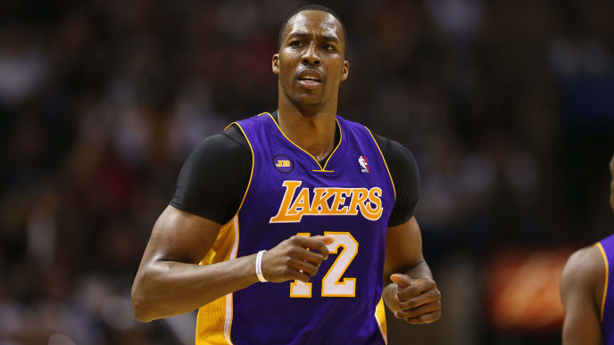 SAN ANTONIO, TX - APRIL 21:  Dwight Howard #12 of the Los Angeles Lakers during Game One of the Western Conference Quarterfinals of the 2013 NBA Playoffs at AT&T Center on April 21, 2013 in San Antonio, Texas. NOTE TO USER: User expressly acknowledges and agrees that, by downloading and or using this photograph, User is consenting to the terms and conditions of the Getty Images License Agreement.  (Photo by Ronald Martinez/Getty Images)