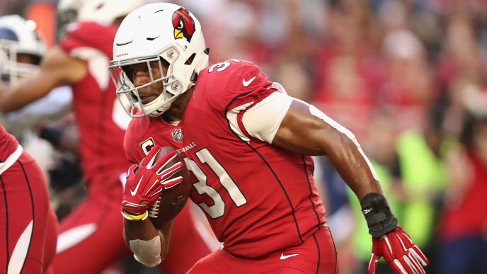 GLENDALE, ARIZONA - DECEMBER 23:  Running back David Johnson #31 of the Arizona Cardinals rushes the football against the Los Angeles Rams during the NFL game at State Farm Stadium on December 23, 2018 in Glendale, Arizona. The Rams defeated the Cardinals 31-9. (Photo by Christian Petersen/Getty Images)