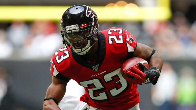 ATLANTA, GA - OCTOBER 20: Brian Hill #23 of the Atlanta Falcons rushes in the second half of an NFL game against the Los Angeles Rams at Mercedes-Benz Stadium on October 20, 2019 in Atlanta, Georgia. (Photo by Todd Kirkland/Getty Images)