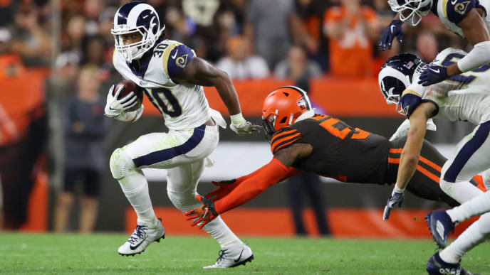 CLEVELAND, OHIO - SEPTEMBER 22: Todd Gurley #30 of the Los Angeles Rams tries avoids the tackle of Mack Wilson #51 of the Cleveland Browns during a fourth quarter run at FirstEnergy Stadium on September 22, 2019 in Cleveland, Ohio. (Photo by Gregory Shamus/Getty Images)