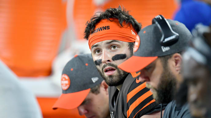 CLEVELAND, OHIO - SEPTEMBER 22: Quarterback Baker Mayfield #6 of the Cleveland Browns looks to the scoreboard while on the bench during the third quarter against the Los Angeles Rams at FirstEnergy Stadium on September 22, 2019 in Cleveland, Ohio. The Rams defeated the Browns 20-13.  (Photo by Jason Miller/Getty Images)