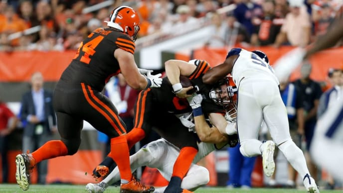 CLEVELAND, OH - SEPTEMBER 22:  Baker Mayfield #6 of the Cleveland Browns is sacked by Clay Matthews #52 of the Los Angeles Rams and Dante Fowler Jr. #56 during the third quarter at FirstEnergy Stadium on September 22, 2019 in Cleveland, Ohio. (Photo by Kirk Irwin/Getty Images)