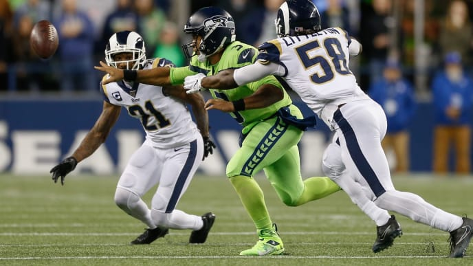 SEATTLE, WA - OCTOBER 03:  Quarterback Russell Wilson #3 of the Seattle Seahawks shovel passes against linebacker Cory Littleton #58 of the Los Angeles Rams at CenturyLink Field on October 3, 2019 in Seattle, Washington.  (Photo by Otto Greule Jr/Getty Images)