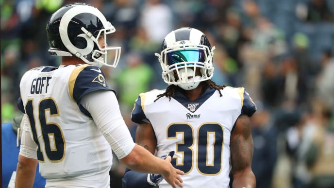 SEATTLE, WASHINGTON - OCTOBER 03: Jared Goff #16 and Todd Gurley #30 of the Los Angeles Rams have a conversation prior to taking on the Seattle Seahawks during their game at CenturyLink Field on October 03, 2019 in Seattle, Washington. (Photo by Abbie Parr/Getty Images)