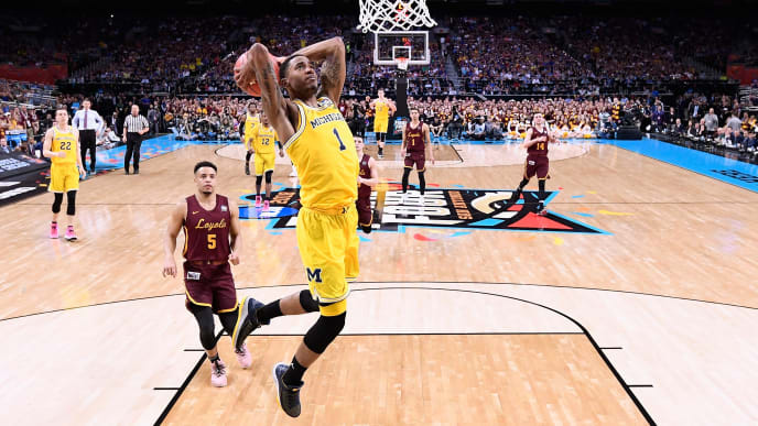 SAN ANTONIO, TX - MARCH 31: Charles Matthews #1 of the Michigan Wolverines goes up for a dunk in the second half against the Loyola Ramblers in the 2018 NCAA Men's Final Four semifinal game at the Alamodome on March 31, 2018 in San Antonio, Texas.  (Photo by Jamie Schwaberow - Pool/Getty Images)