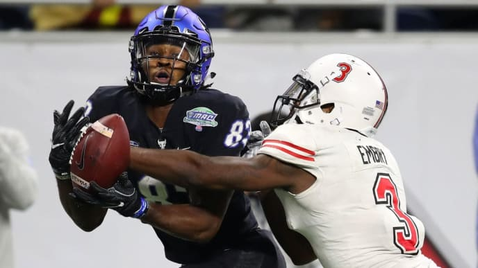 DETROIT, MICHIGAN - NOVEMBER 30: Anthony Johnson #83 of the Buffalo Bulls can't come up with a late fourth quarter catch in front of Jalen Embry #3 of the Northern Illinois Huskies during the MAC Championship at Ford Field on November 30, 2018 in Detroit, Michigan. Northern Illinois won the game 30-29. (Photo by Gregory Shamus/Getty Images)