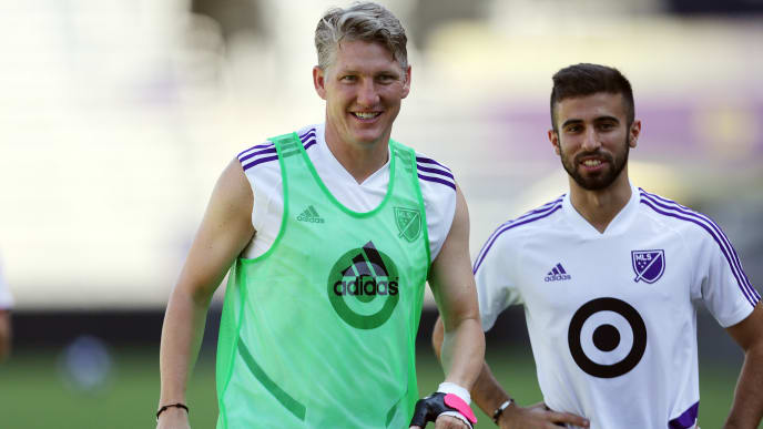 ORLANDO, FL - JULY 30: Bastian Schweinsteiger (L) and Diego Rossi (R) of MLS All-Star Team warm up during a training session ahead of the 2019 MLS All-Star Game at Exploria Stadium on July 30, 2019 in Orlando, Florida.  (Photo by Omar Vega/Getty Images)