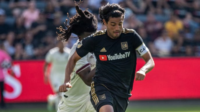 LOS ANGELES, CA - OCTOBER 6: Carlos Vela #10 of Los Angeles FC goes past Lalas Abubakar #6 of Colorado Rapids during Los Angeles FC's MLS match against Sporting Kansas City at the Banc of California Stadium on October 6, 2019 in Los Angeles, California. Los Angeles FC won the match 3-1 (Photo by Shaun Clark/Getty Images)