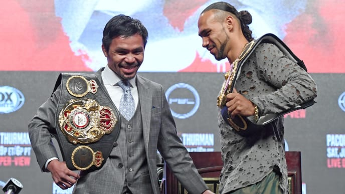 LAS VEGAS, NEVADA - JULY 17:  WBA welterweight champion Manny Pacquiao (L) and WBA welterweight super champion Keith Thurman joke around after posing during a news conference at MGM Grand Garden Arena on July 17, 2019 in Las Vegas, Nevada. The two will meet in a WBA welterweight title fight on July 20 at MGM Grand Garden Arena.  (Photo by Ethan Miller/Getty Images)
