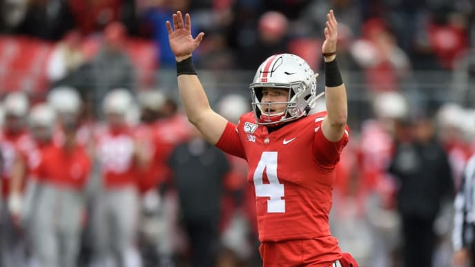 COLUMBUS, OH - NOVEMBER 09:  Chris Chugunov #4 of the Ohio State Buckeyes celebrates after throwing a touchdown against the Maryland Terrapins at Ohio Stadium on November 9, 2019 in Columbus, Ohio. (Photo by G Fiume/Maryland Terrapins/Getty Images)