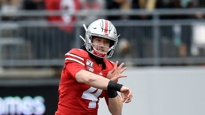 COLUMBUS, OH - NOVEMBER 09:  Chris Chugunov #4 of the Ohio State Buckeyes thows a pass against the Maryland Terrapins at Ohio Stadium on November 9, 2019 in Columbus, Ohio.  (Photo by G Fiume/Maryland Terrapins/Getty Images)