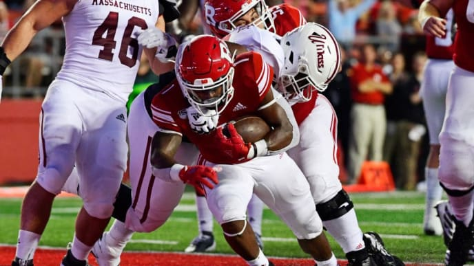 PISCATAWAY, NJ - AUGUST 30: Isaih Pacheco #1 of the Rutgers Scarlet Knights muscles his way to a touchdown against Dennis Osagiede #99 of the Massachusetts Minutemen during the first quarter at SHI Stadium on August 30, 2019 in Piscataway, New Jersey. (Photo by Corey Perrine/Getty Images)