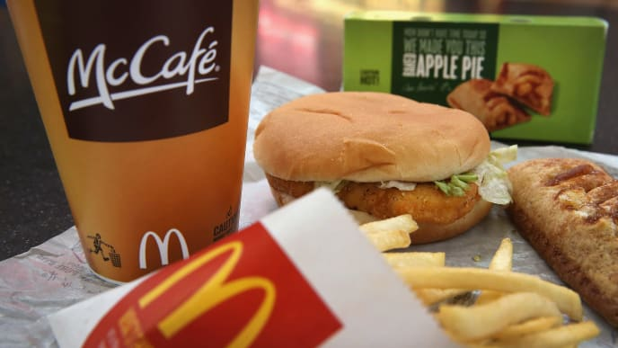 DES PLAINES, IL - OCTOBER 24:  In this photo illustration, a McChicken sandwich sits with typical Dollar Menu items sold at a  McDonald's restaurant on October 24, 2013 in Des Plaines, Illinois. McDonald's has announced it will make changes to its low-priced Dollar Menu, which includes items like coffee, small fries, hamburgers and apple pies. The new menu, dubbed the Dollar Menu and More, will offer some higher priced options such as the grilled Onion Cheddar Burger and a McChicken sandwich.  (Photo Illustration by Scott Olson/Getty Images)