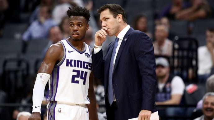 SACRAMENTO, CALIFORNIA - OCTOBER 16:  Head coach Luke Walton of the Sacramento Kings talks to Buddy Hield #24 during their game against the Melbourne United at Golden 1 Center on October 16, 2019 in Sacramento, California. NOTE TO USER: User expressly acknowledges and agrees that, by downloading and or using this photograph, User is consenting to the terms and conditions of the Getty Images License Agreement. (Photo by Ezra Shaw/Getty Images)