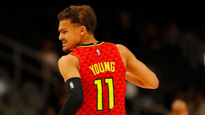 ATLANTA, GEORGIA - MARCH 13:  Trae Young #11 of the Atlanta Hawks reacts after hitting a three-point basket against the Memphis Grizzlies at State Farm Arena on March 13, 2019 in Atlanta, Georgia.  NOTE TO USER: User expressly acknowledges and agrees that, by downloading and or using this photograph, User is consenting to the terms and conditions of the Getty Images License Agreement. (Photo by Kevin C.  Cox/Getty Images)