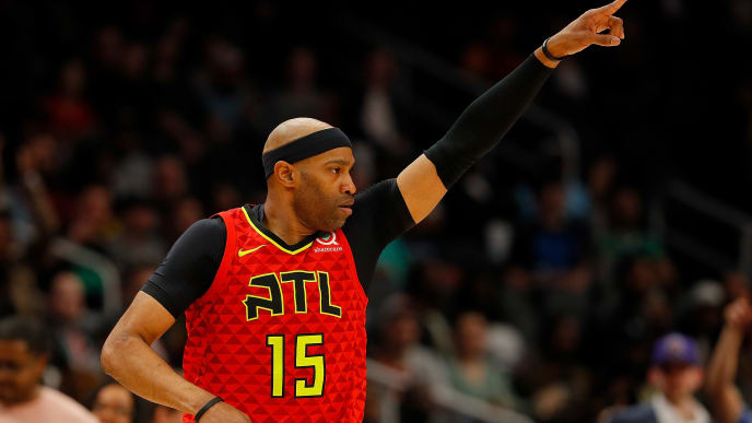 ATLANTA, GEORGIA - MARCH 13:  Vince Carter #15 of the Atlanta Hawks reacts after hitting a three-point basket against the Memphis Grizzlies in the first half at State Farm Arena on March 13, 2019 in Atlanta, Georgia.  NOTE TO USER: User expressly acknowledges and agrees that, by downloading and or using this photograph, User is consenting to the terms and conditions of the Getty Images License Agreement. (Photo by Kevin C.  Cox/Getty Images)
