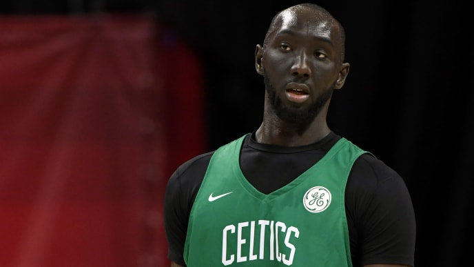 LAS VEGAS, NEVADA - JULY 11:  Tacko Fall #55 of the Boston Celtics stands on the court during a game against the Memphis Grizzlies during the 2019 NBA Summer League at the Thomas & Mack Center on July 11, 2019 in Las Vegas, Nevada. The Celtics defeated the Grizzlies 113-87. NOTE TO USER: User expressly acknowledges and agrees that, by downloading and or using this photograph, User is consenting to the terms and conditions of the Getty Images License Agreement.  (Photo by Ethan Miller/Getty Images)