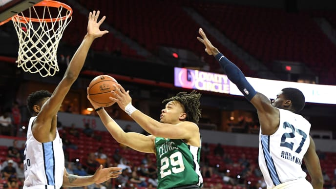 LAS VEGAS, NEVADA - JULY 11:  Carsen Edwards #29 of the Boston Celtics drives to the basket against Bruno Caboclo #5 and Shaq Buchanan #27 of the Memphis Grizzlies during the 2019 NBA Summer League at the Thomas & Mack Center on July 11, 2019 in Las Vegas, Nevada. The Celtics defeated the Grizzlies 113-87. NOTE TO USER: User expressly acknowledges and agrees that, by downloading and or using this photograph, User is consenting to the terms and conditions of the Getty Images License Agreement.  (Photo by Ethan Miller/Getty Images)