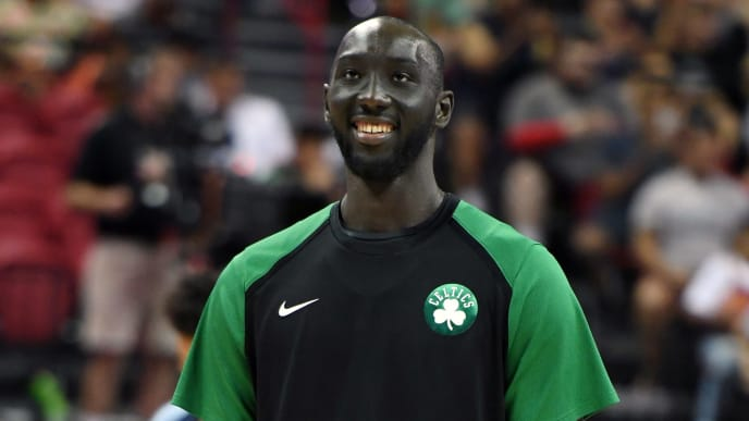 LAS VEGAS, NEVADA - JULY 11:  Tacko Fall #55 of the Boston Celtics smiles during warmups before a game against the Memphis Grizzlies during the 2019 NBA Summer League at the Thomas & Mack Center on July 11, 2019 in Las Vegas, Nevada. The Celtics defeated the Grizzlies 113-87. NOTE TO USER: User expressly acknowledges and agrees that, by downloading and or using this photograph, User is consenting to the terms and conditions of the Getty Images License Agreement.  (Photo by Ethan Miller/Getty Images)