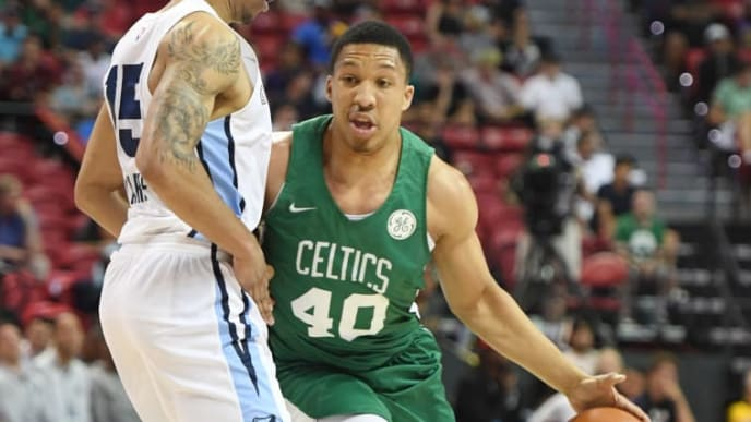 LAS VEGAS, NEVADA - JULY 11:  Grant Williams #40 of the Boston Celtics brings the ball up the court against Brandon Clarke #15 of the Memphis Grizzlies during the 2019 NBA Summer League at the Thomas & Mack Center on July 11, 2019 in Las Vegas, Nevada. The Celtics defeated the Grizzlies 113-87. NOTE TO USER: User expressly acknowledges and agrees that, by downloading and or using this photograph, User is consenting to the terms and conditions of the Getty Images License Agreement.  (Photo by Ethan Miller/Getty Images)