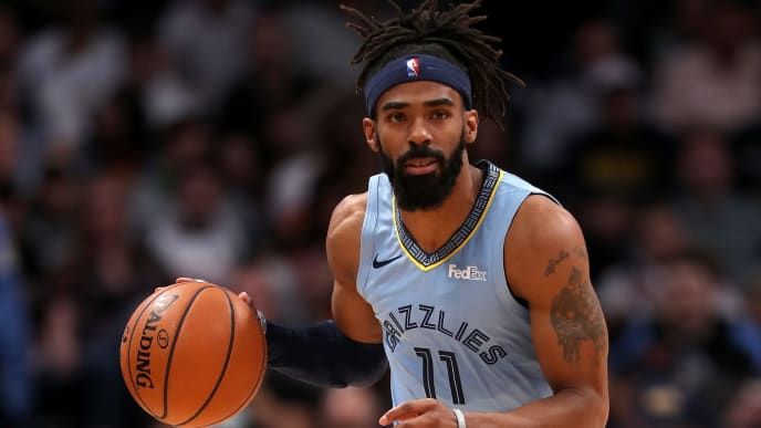 DENVER, CO - DECEMBER 10:  Mike Conley #11 of the Memphis Grizzlies plays the Denver Nuggets at the Pepsi Center on December 10, 2018 in Denver, Colorado. NOTE TO USER: User expressly acknowledges and agrees that, by downloading and or using this photograph, User is consenting to the terms and conditions of the Getty Images License Agreement.  (Photo by Matthew Stockman/Getty Images)