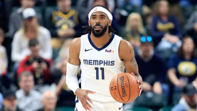 INDIANAPOLIS, IN - OCTOBER 17:  Mike Conley #11 of the Memphis Grizzlies dribbles the ball during the game against the Indiana Pacers at Bankers Life Fieldhouse on October 17, 2018 in Indianapolis, Indiana.  NOTE TO USER: User expressly acknowledges and agrees that, by downloading and or using this photograph, User is consenting to the terms and conditions of the Getty Images License Agreement.  (Photo by Andy Lyons/Getty Images)