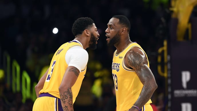 LOS ANGELES, CA - OCTOBER 29: LeBron James #23 is congratulated by Anthony Davis #3 of the Los Angeles Lakers after scoring a basket against Memphis Grizzlies during the second half at Staples Center on October 29, 2019 in Los Angeles, California. NOTE TO USER: User expressly acknowledges and agrees that, by downloading and/or using this Photograph, user is consenting to the terms and conditions of the Getty Images License Agreement.(Photo by Kevork Djansezian/Getty Images)
