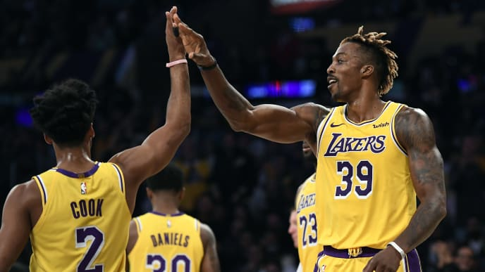 LOS ANGELES, CA - OCTOBER 29: Dwight Howard #39 of the Los Angeles Lakers is congratulated by Quinn Cook #2 of the Los Angeles Lakers after a blocked shot against Marko Guduric #23 of the Memphis Grizzlies during the second half of the basketball game at Staples Center on October 29, 2019 in Los Angeles, California. NOTE TO USER: User expressly acknowledges and agrees that, by downloading and/or using this Photograph, user is consenting to the terms and conditions of the Getty Images License Agreement. (Photo by Kevork Djansezian/Getty Images)