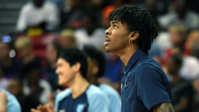 LAS VEGAS, NEVADA - JULY 15:  Ja Morant of the Memphis Grizzlies looks on as his teammates take on the Minnesota Timberwolves in the championship game of the 2019 NBA Summer League at the Thomas & Mack Center on July 15, 2019 in Las Vegas, Nevada. The Grizzlies defeated the Timberwolves 95-92. NOTE TO USER: User expressly acknowledges and agrees that, by downloading and or using this photograph, User is consenting to the terms and conditions of the Getty Images License Agreement.  (Photo by Ethan Miller/Getty Images)