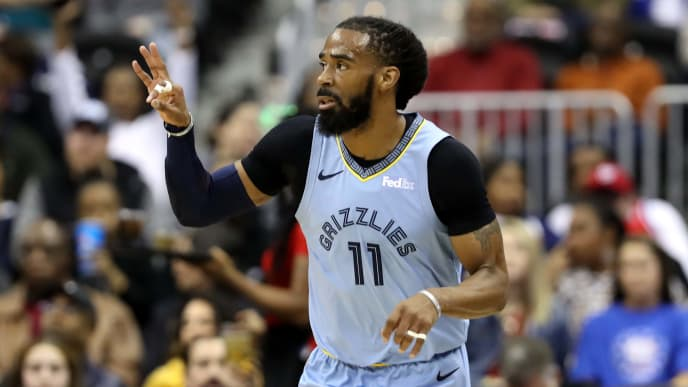 WASHINGTON, DC - MARCH 16: Mike Conley #11 of the Memphis Grizzlies celebrates after hitting a three pointer against the Washington Wizards in the first half at Capital One Arena on March 16, 2019 in Washington, DC. NOTE TO USER: User expressly acknowledges and agrees that, by downloading and or using this photograph, User is consenting to the terms and conditions of the Getty Images License Agreement. (Photo by Rob Carr/Getty Images)