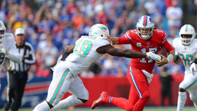 ORCHARD PARK, NY - OCTOBER 20:  Josh Allen #17 of the Buffalo Bills runs the ball and blocks Sam Eguavoen #49 of the Miami Dolphins during the first quarter at New Era Field on October 20, 2019 in Orchard Park, New York.  (Photo by Timothy T Ludwig/Getty Images)