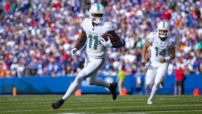 ORCHARD PARK, NY - OCTOBER 20:  DeVante Parker #11 of the Miami Dolphins runs with a touchdown reception during the second quarter against the Buffalo Bills at New Era Field on October 20, 2019 in Orchard Park, New York. Buffalo defeats Miami 31-21.  (Photo by Brett Carlsen/Getty Images)