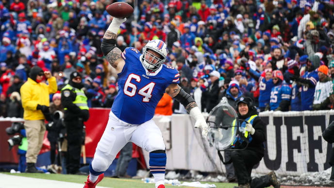 ORCHARD PARK, NY - DECEMBER 17:  Richie Incognito #64 of the Buffalo Bills spikes the ball after LeSean McCoy #25 of the Buffalo Bills scored a touchdown during the first quarter against the Miami Dolphins on December 17, 2017 at New Era Field in Orchard Park, New York.  (Photo by Tom Szczerbowski/Getty Images)