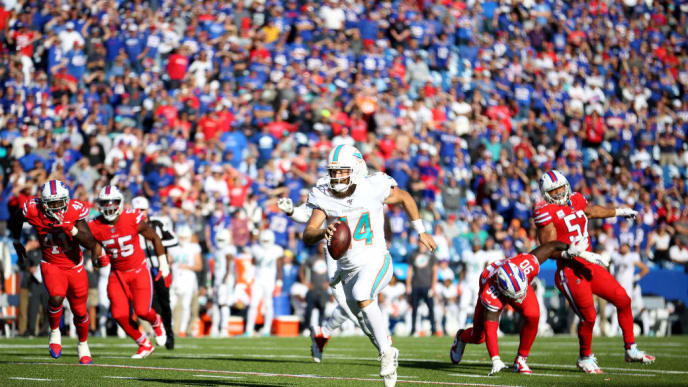 ORCHARD PARK, NEW YORK - OCTOBER 20: Ryan Fitzpatrick #14 of the Miami Dolphins runs the ball for a touchdown during the fourth quarter of an NFL game against the Buffalo Bills at New Era Field on October 20, 2019 in Orchard Park, New York. (Photo by Bryan M. Bennett/Getty Images)