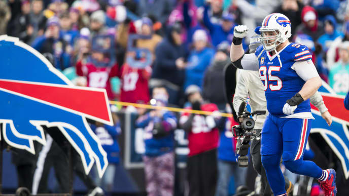 ORCHARD PARK, NY - DECEMBER 30:  Kyle Williams #95 of the Buffalo Bills runs onto the field for his last game as an NFL player against the Miami Dolphins at New Era Field on December 30, 2018 in Orchard Park, New York.  (Photo by Brett Carlsen/Getty Images)
