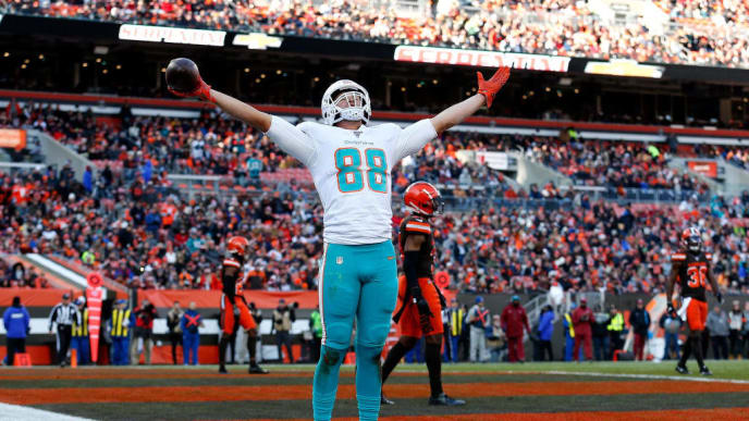 CLEVELAND, OH - NOVEMBER 24:  Mike Gesicki #88 of the Miami Dolphins celebrates after catching a pass for a touchdown during the third quarter of the game against the Cleveland Browns at FirstEnergy Stadium on November 24, 2019 in Cleveland, Ohio. (Photo by Kirk Irwin/Getty Images)