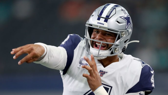 ARLINGTON, TEXAS - SEPTEMBER 22: Dak Prescott #4 of the Dallas Cowboys works through pregame warm ups before taking on the Miami Dolphins at AT&T Stadium on September 22, 2019 in Arlington, Texas. (Photo by Tom Pennington/Getty Images)