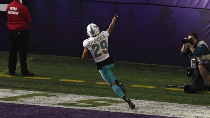 MINNEAPOLIS, MN - DECEMBER 16: Minkah Fitzpatrick #29 of the Miami Dolphins celebrates scoring a touchdown  after intercepting a pass by Kirk Cousins #8 of the Minnesota Vikings in the second quarter of the game at U.S. Bank Stadium on December 16, 2018 in Minneapolis, Minnesota. Fitzpatrick scored a 50 yard touchdown on the play. (Photo by Hannah Foslien/Getty Images)